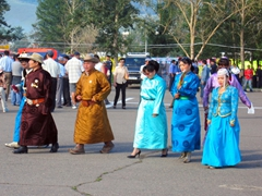 Mongolians dressed in their finest deel, reserved for special occasions