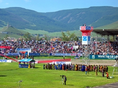 View of the Naadam Stadium, filled to maximum capacity with an excited crowd