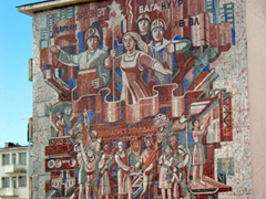 Soviet style mural on the side of a building; Ulan Bator