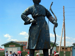 A statue of an archer; outside of the archery section of the Naadam Festival; Ulan Bator