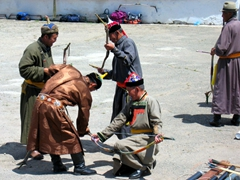 Archers stretching their bows and preparing for the competition; Naadam Festival