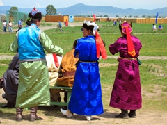 Mongolian women wearing colorful deel, traditional clothing worn on festive occasions