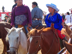 Family members wait in anticipation for the competitors to reach the finish line; Naadam Festival