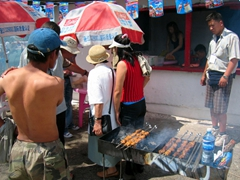 Shashlik (marinated skewered meat) on the grill; Naadam Festival grounds