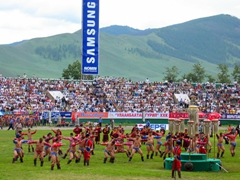 Mongolian wrestlers performing an eagle dance (devekh) at the closing ceremonies of the 2004 Naadam Festival