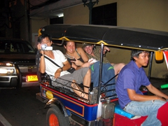 Anh Long, Becky and Robby smile during tuk-tuk races in Bangkok