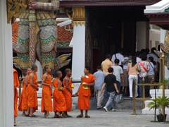 A group of Buddhist monks in line to visit the Wat Phra Kaew temple
