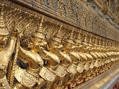 Golden Garudas and Nagas line the exterior of the Ubosoth of the Emerald Buddha; Grand Palace