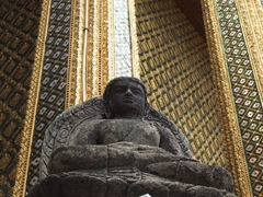 Portrait of a stone statue just outside the magnificent Temple of Emerald Buddha; Grand Palace, Bangkok