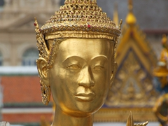 Face of a kinnorn (a mythical half man, half bird) at the Grand Palace of Wat Phra Kaew