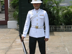 A soldier from the Royal Guards stands guard at the Grand Palace; Bangkok