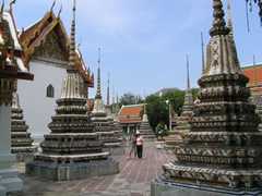 Robby and Ann strike a pose in between stupas at Wat Pho