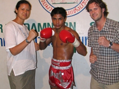 Striking a pose with the Muay Thai champion; Bangkok