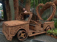 "Robby hanging out in a ""jeep"" made out of clay pots; Nong Nooch's Clay Pot Garden Display"