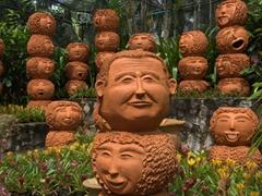 Unique individual faces on clay pots at the Nong Nooch Garden