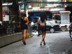 Two tired lady boys head back towards Walking Street; Pattaya