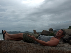 Robby strikes a pose near Hin Ta (grandpa) rock formation, which has long been a subject of mirth as it represents male genitalia; Ko Samui
