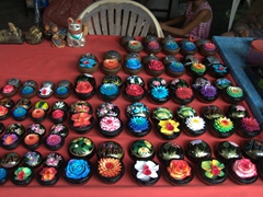 Colorful soap shaped as flowers for sale; Hin Ta and Hin Yai rock formation in Lamai Beach