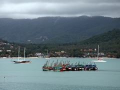 Colorful fishing boats off the coast of Ko Samui