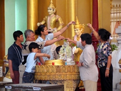 Everyone born on a Friday pours water over the Venus planetary post; Shwezigon Pagoda