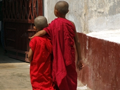 Two young monks strolling through Shwezigon Pagoda