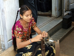 Young woman showing how to make lacquer ware baskets