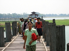 Pedestrians crossing the famous 1.2 km teak footbridge; U Bein
