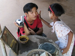 This young girl carefully applied thanakha to Anh Long's cheeks and forehead