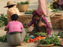 Bargaining over fresh vegetables; Bagan market