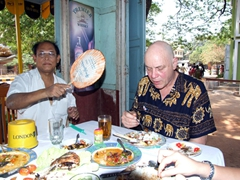 Bob enjoying a spicy lunch and personal fan at a local Burmese restaurant