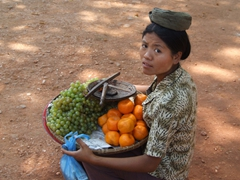Fruit seller taking a short break; Salay