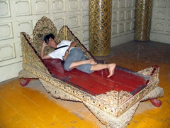 Anh Long reclining on the emperor's bed; Mandalay Royal Palace