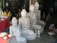 "Lots of marble Buddhas for sale on ""carver's street""; Mandalay"