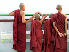 Four monks wait for the sun to set; Mandalay hill lookout point