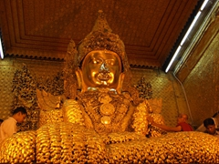 The sacred Buddha at Mahamuni pagoda; one of Myanmar's most holy sites
