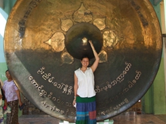 Becky can only reach halfway up the huge gong beside the Mahamuni pagoda; Mandalay
