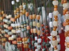 Beaded stone necklaces for sale; stone carver's street; Mandalay