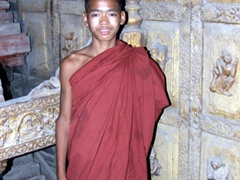 A young monk is eager to have his photo taken; Mandalay