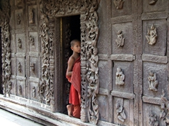 A fleeting glimpse of a red robed monk; Shwenandaw monastery