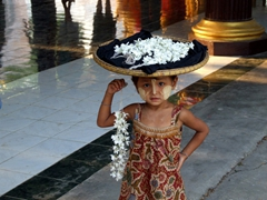 Young girl selling flowers at the Kuthodaw Paya