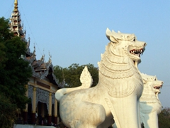 Two massive lions mark the base of Mandalay hill