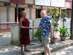 Bob discussing hair styles (or lack thereof) with a monk; Maha Ganayon Kyaung monastery