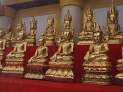 Dozens of golden Buddhas are carefully protected at the Bagaya Kyaung monastery