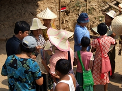 Straw hats for sale; everyone gets in on the action at the Myitnge River crossing