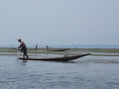 Fishermen wrapping up their fishing trip before sunset; Inle Lake