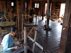Lady spinning string made from the lotus plant; Inle Lake