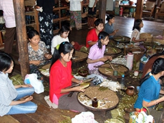 Young ladies making handmade cheroots; Inle Lake