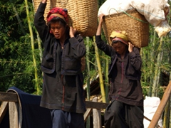 Pa-O ladies carrying a heavy load from the market; Indein village, Inle Lake