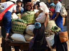 Pa-O tribe loading their goods purchased at the market; Indein village