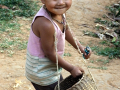 Indein village child smiling for a photo; Inle Lake